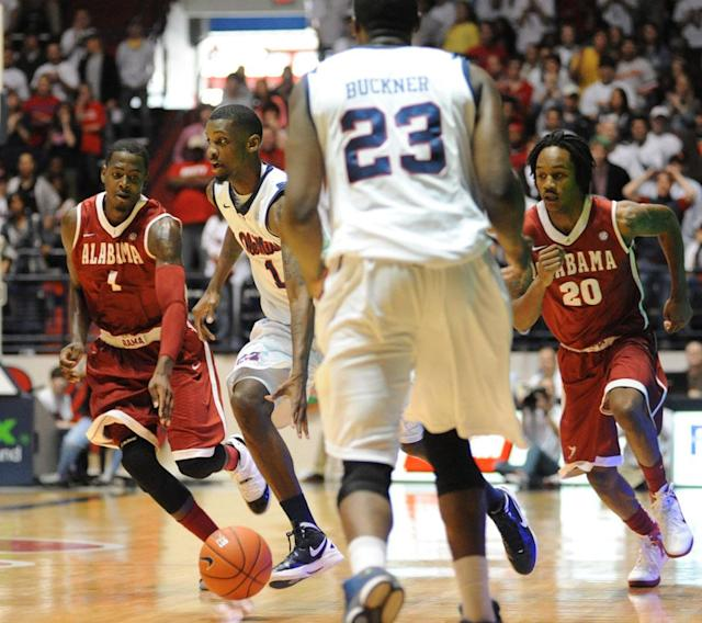 Mississippi's Terrance Henry (1) brings the ball up court against Alabama's JaMychal Green (1) and Levi Randolph (20) during an NCAA college basketball game in Oxford, Miss. on Saturday, March 3, 2012.