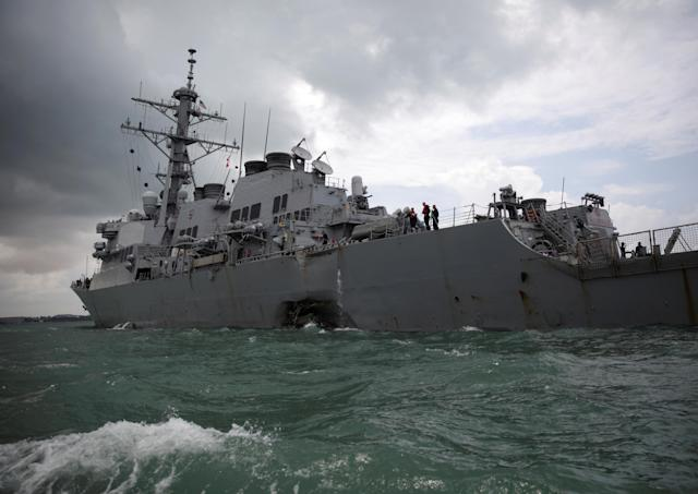 <p>The U.S. Navy guided-missile destroyer USS John S. McCain is seen after a collision, in Singapore waters Aug. 21, 2017. (Photo: Ahmad Masood/Reuters) </p>