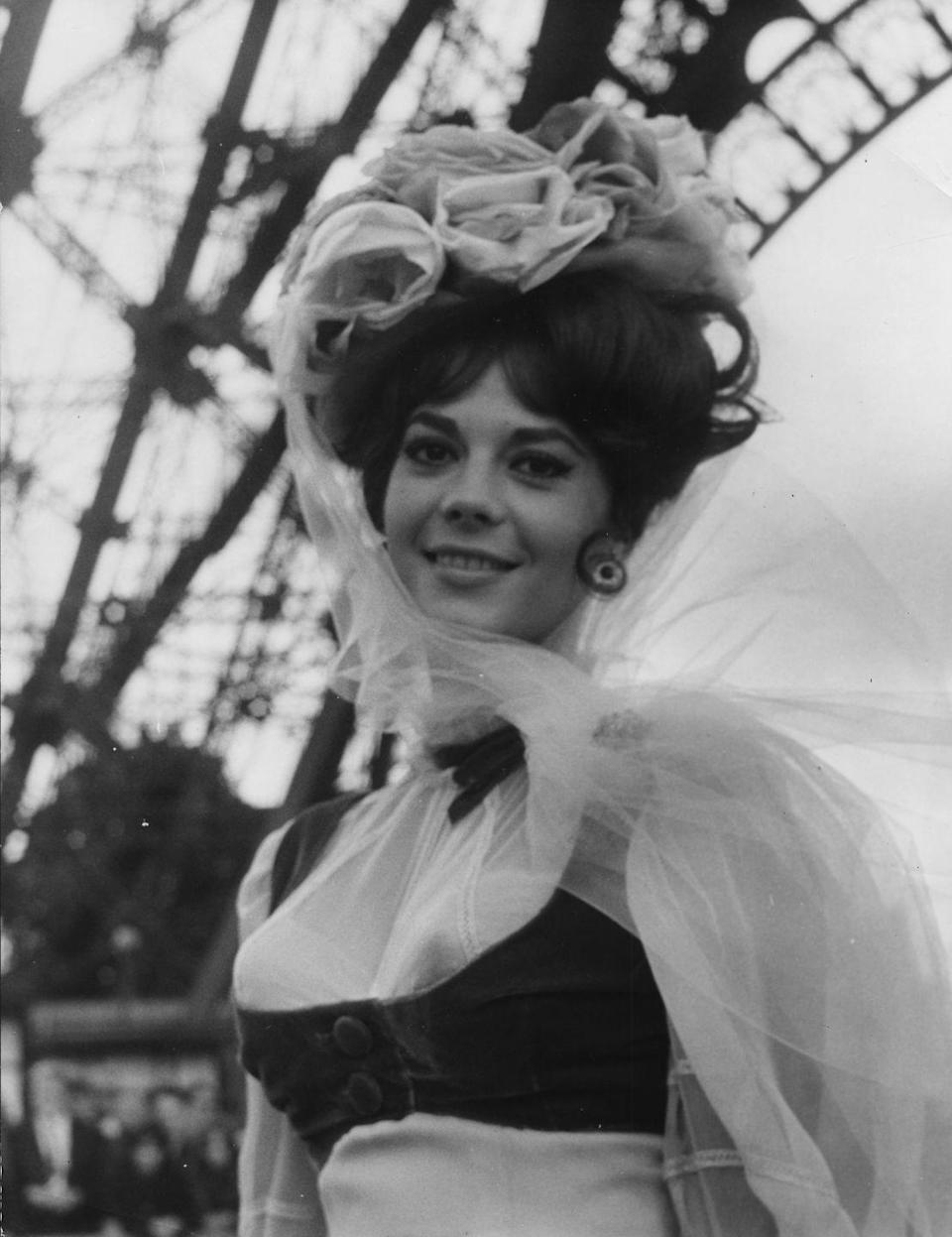 <p>The actress looks regal in a floral headpiece on the set of her hit comedy, <em>The Great Race</em>.</p>