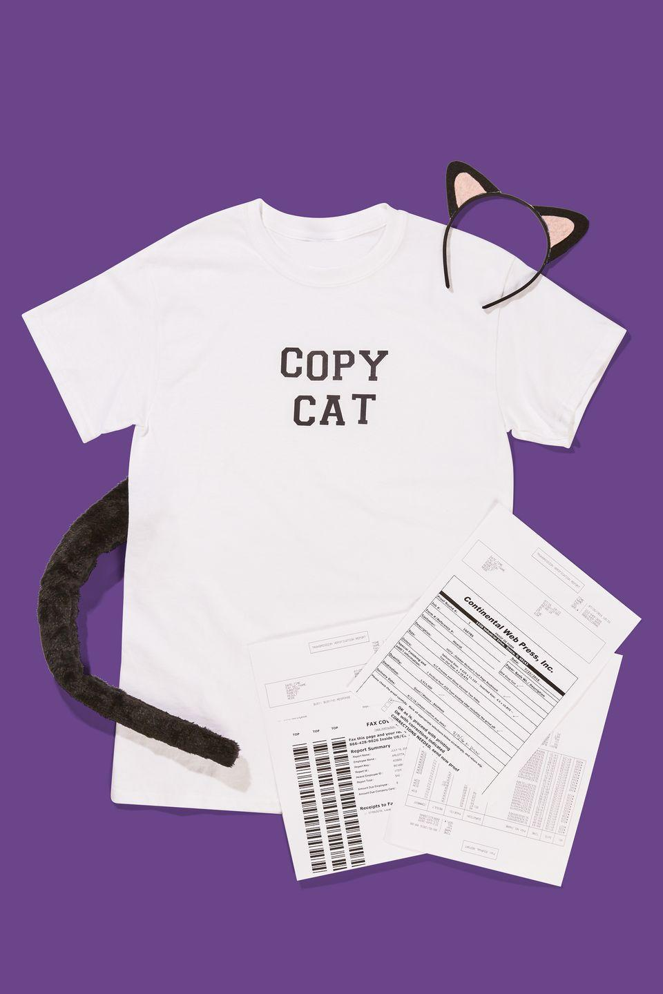"""<p>Attach black adhesive letters to spell out """"Copy Cat"""" on a white t-shirt. Add cat ears and a tail, grab random work papers (preferably unimportant ones) to carry around, and try not to purr too loudly in anyone's ear. </p><p><a class=""""link rapid-noclick-resp"""" href=""""https://www.amazon.com/Creavention-Cosplay-headband-accessories-parties/dp/B01I4FUU0C?tag=syn-yahoo-20&ascsubtag=%5Bartid%7C10070.g.490%5Bsrc%7Cyahoo-us"""" rel=""""nofollow noopener"""" target=""""_blank"""" data-ylk=""""slk:CAT ACCESSORIES""""><strong>CAT ACCESSORIES</strong> </a></p>"""