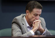FILE - In this June 15, 2017, file photo, Louisville basketball coach Rick Pitino listens during an NCAA college basketball news conference in Louisville, Ky. Rick Pitino survived sex scandals and FBI investigations , won national championships , and when his coaching options seemingly dried up , he left for Greece. Somehow , the winding road of his career took him to Iona - and back in the NCAA Tournament. The last stop - he swears it's true - of his career. (Alton Strupp/The Courier-Journal via AP, File)