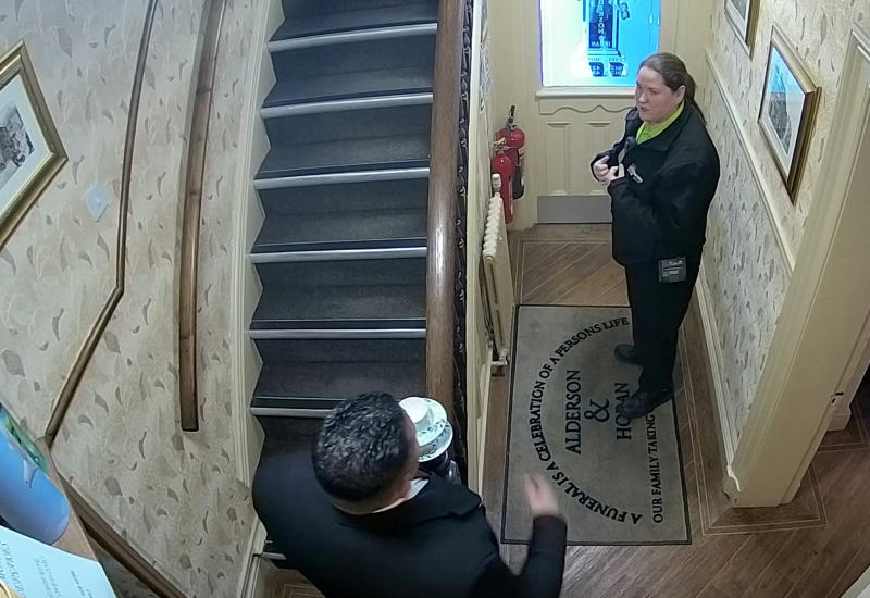 CCTV of Ann Bentley & John Harpur being confronted by council officers. (SWNS)