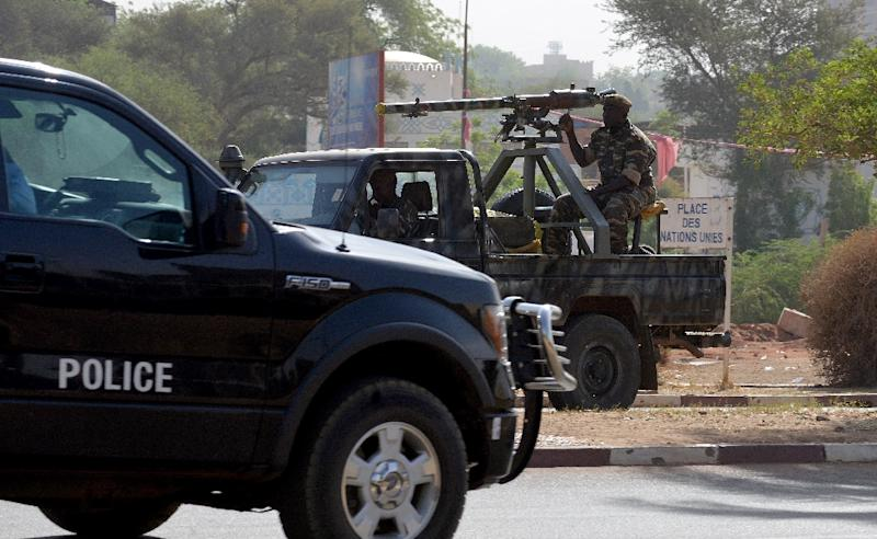 Soldiers patrol in the streets of Niamey, Niger on March 19, 2016