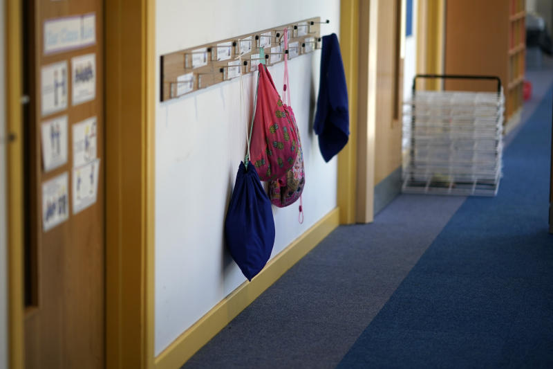 "ALTRINCHAM, ENGLAND - APRIL 08: Children's PE bags hang on coat hooks at Oldfield Brow Primary School during the coronavirus lockdown on April 08, 2020 in Altrincham, England. The government announced the closure of UK schools from March 20 except for the children of key workers, such as NHS staff, and vulnerable pupils, such as those looked after by local authorities. The prime minister has said schools will remain closed ""until further notice,"" and many speculate they may not reopen until next term. (Photo by Christopher Furlong/Getty Images)"