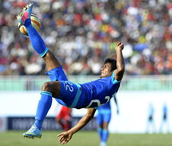 Syed Rahim Nabi kicks the ball against Nepal