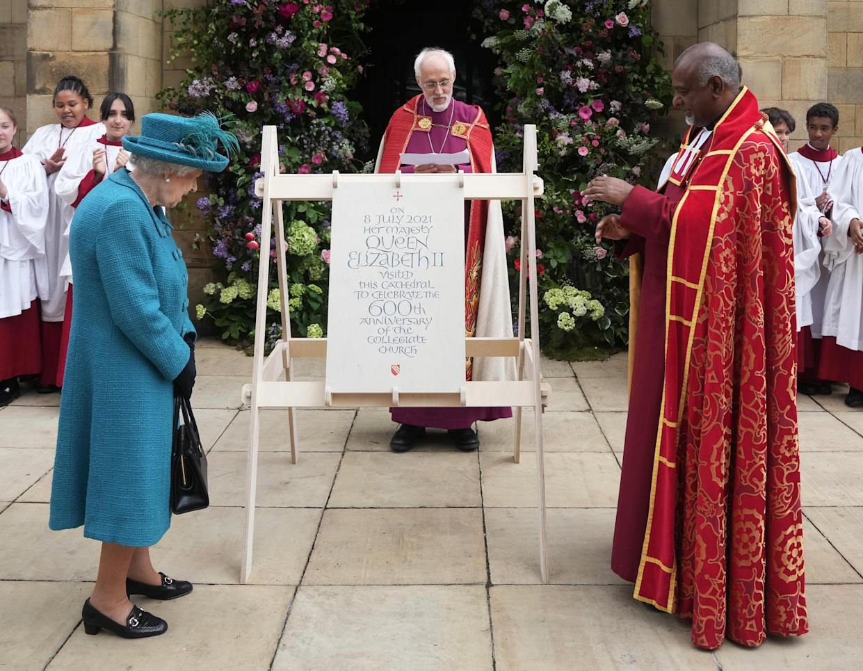 MANCHESTER, ENGLAND - JULY 08: (EDITORS NOTE: This image is a recrop of #1233866709) Queen Elizabeth II is shown a plaque commemorating her visit by Dean of Manchester Cathedral, Rogers Govender at Manchester Cathedral on July 8, 2021 in Manchester, England. (Photo by Christopher Furlong/Getty Images)