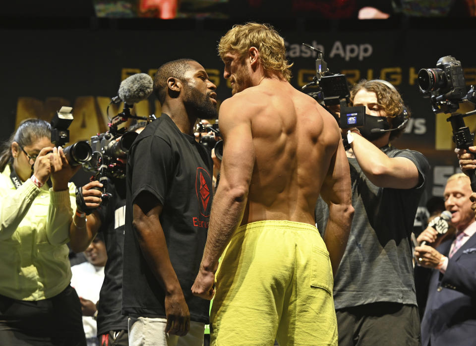 HOLLYWOOD FL - JUNE 05: Floyd Mayweather Jr. weighing in at 155 lbs and Logan Paul weighing in at 189.5 lbs as they face off during the weigh in at Hard Rock Live held at the Seminole Hard Rock and Casino for there exhibition fight on June 6th at Hard Rock Stadium on June 5, 2021 in Hollywood, Florida.Credit: mpi04/MediaPunch /IPX
