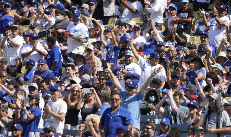 Los Angeles, CA - October 03:  Los Angeles Dodgers fans celebrates after Trea Turner #6 of the Los Angeles Dodgers hit a grand slam against the Milwaukee Brewers in the fifth inning of a baseball game at Dodger Stadium in Los Angeles on Sunday, October 3, 2021. (Photo by Keith Birmingham/MediaNews Group/Pasadena Star-News via Getty Images)