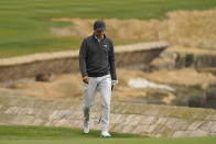 Jordan Spieth walks up to the 18th green of the Pebble Beach Golf Links during the final round of the AT&T Pebble Beach Pro-Am golf tournament Sunday, Feb. 14, 2021, in Pebble Beach, Calif. (AP Photo/Eric Risberg)