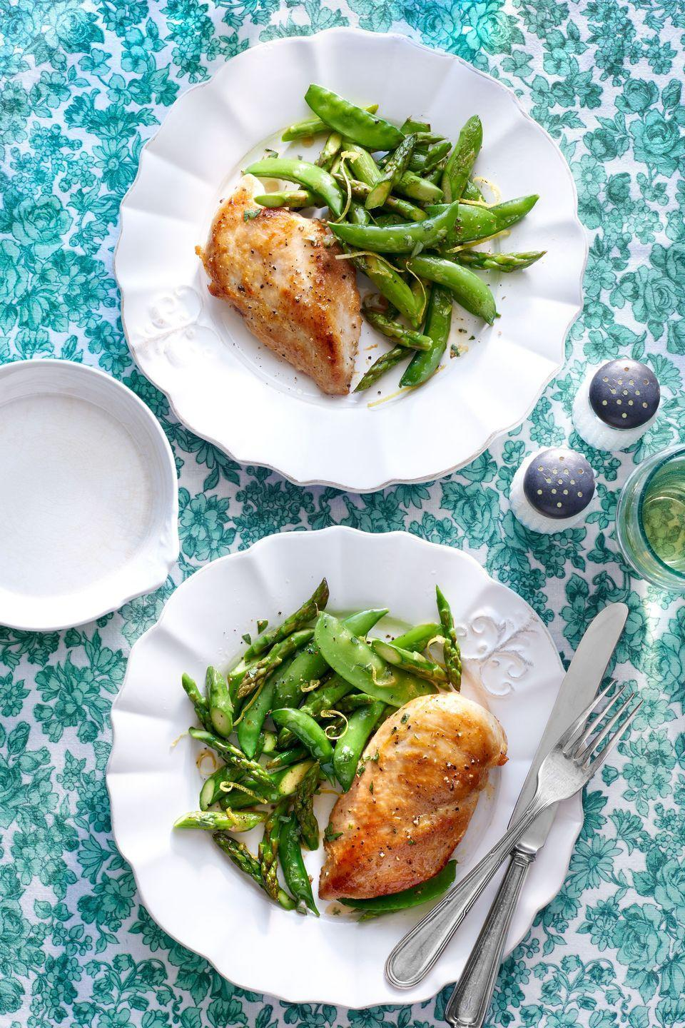 """<p>Fresh spring vegetables are an easy (and healthy!) way to upgrade a classic chicken dinner. Bonus: This dish takes less than 25 minutes to prepare. </p><p><strong><a href=""""https://www.countryliving.com/food-drinks/recipes/a276/skillet-chicken-spring-vegetables-recipe-clx0315/"""" rel=""""nofollow noopener"""" target=""""_blank"""" data-ylk=""""slk:Get the recipe"""" class=""""link rapid-noclick-resp"""">Get the recipe</a>.</strong></p>"""