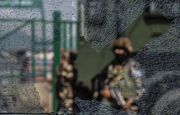 """<span class=""""caption"""">The scene in Srinagar, in Indian-administered Kashmir, after an Aug. 10, 2021, grenade attack by militants that wounded at least nine civilians. Kashmir has experienced sporadic violence for more than seven decades, including three wars.</span> <span class=""""attribution""""><a class=""""link rapid-noclick-resp"""" href=""""https://www.gettyimages.com/detail/news-photo/indian-government-forces-are-seen-through-a-broken-glass-of-news-photo/1234603051?adppopup=true"""" rel=""""nofollow noopener"""" target=""""_blank"""" data-ylk=""""slk:Yawar Nazir/Getty Images"""">Yawar Nazir/Getty Images</a></span>"""