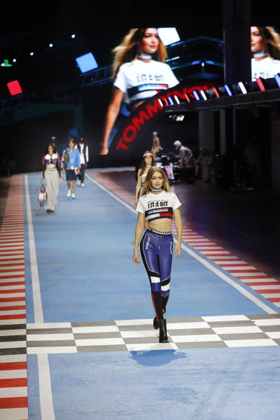 <p> Model Gigi Hadid wears a creation as part of the Tommy Hilfiger women's Fall/Winter 2018-2019 collection, presented during the Milan Fashion Week, in Milan, Italy, Sunday, Feb. 25, 2018. (AP Photo/Antonio Calanni)
