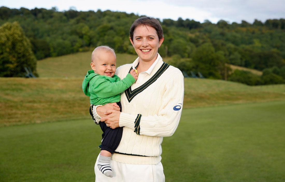 HIGH WYCOMBE, ENGLAND - AUGUST 13: Sarah Elliott of Australia poses for a photograph with her son Sam at the end of day three of the Women's Ashes Series match between England and Australia at Wormsley Cricket Ground on August 13, 2013 in High Wycombe, England. (Photo by Harry Engels/Getty Images)