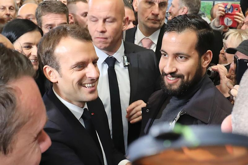 French President Emmanuel Macron pictured in February with his bodyguard Alexandre Benalla, who was caught on video roughing up protesters while wearing a police helmet (AFP Photo/Ludovic MARIN)