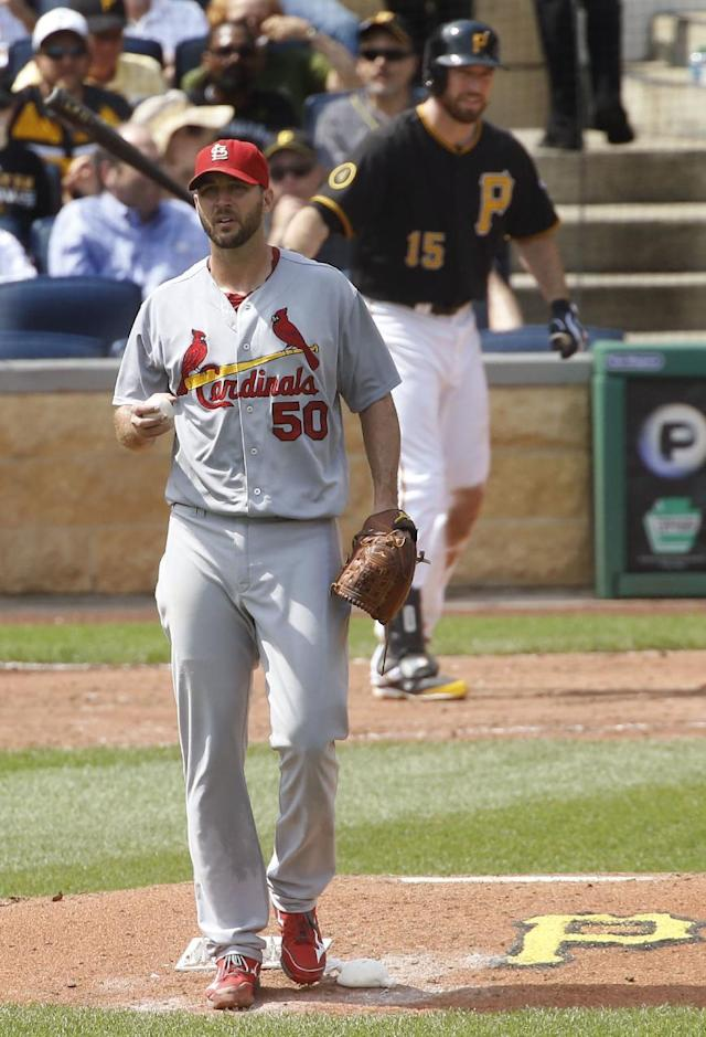 St. Louis Cardinals starting pitcher Adam Wainwright works the rosin bag as Pittsburgh Pirates' Ike Davis comes to bat in the fifth inning of the baseball game on Wednesday, Aug. 27, 2014, in Pittsburgh. (AP Photo/Keith Srakocic)