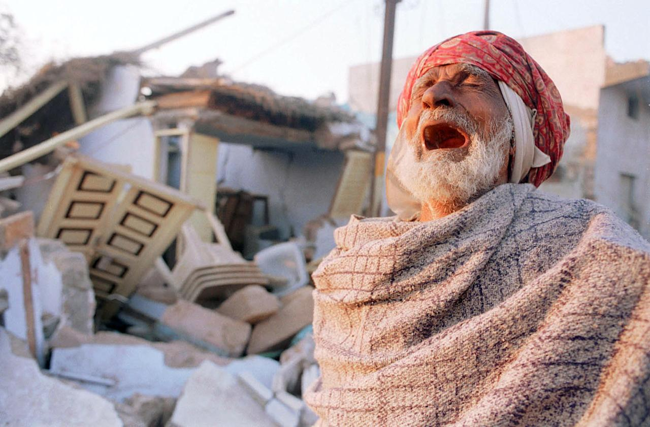 384982 03: A Muslim man weeps infront of his destroyed house January 29, 2001 in Bhuj, India. Bhuj and the surrounding villages in the western indian state of Gujarat lay at the epicenter of Friday's earthquake, which registered 7.9 on the Richter scale, and few structures remain standing amidst the rubble. (Photo by Alyssa Banta/Newsmakers)
