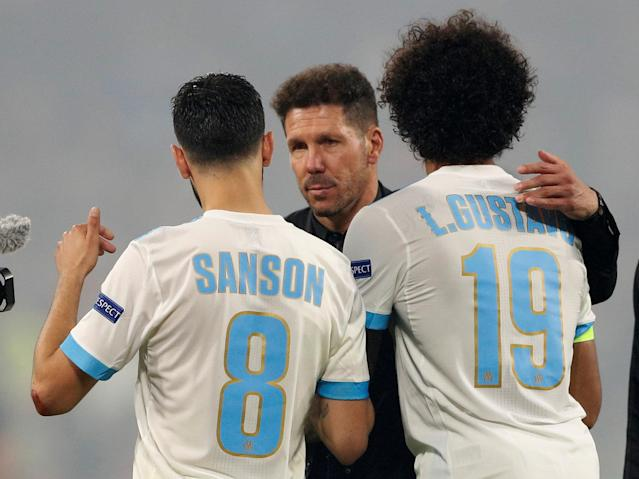 Soccer Football - Europa League Final - Olympique de Marseille vs Atletico Madrid - Groupama Stadium, Lyon, France - May 16, 2018 Atletico Madrid coach Diego Simeone shakes hands with Marseille's Morgan Sanson and Luiz Gustavo after the match REUTERS/John Sibley