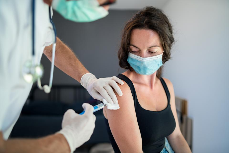 Canadians are now encouraged to receive both the flu shot and the COVID vaccine in tandem or in close proximity to one another. (Image via Getty Images)