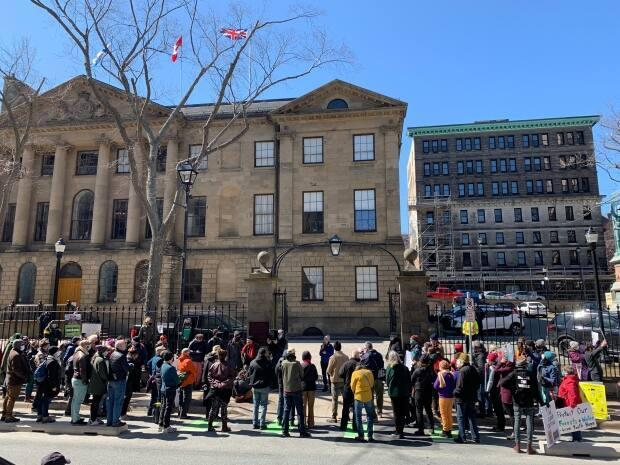 Protesters gathered outside Province House on Tuesday to express their concerns about the government's approach to the environment.
