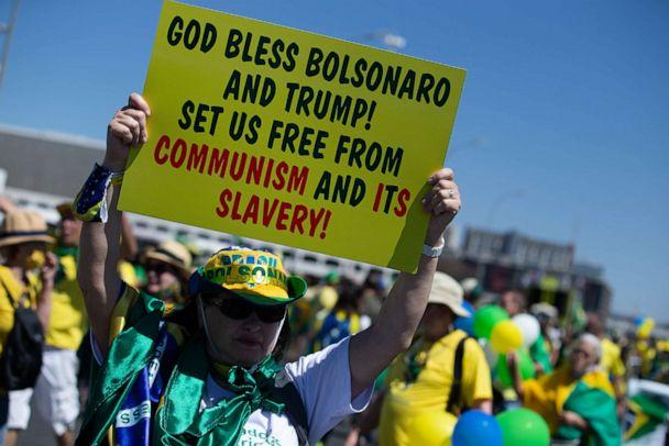 PHOTO: In this Sept. 7, 2020, file photo, a supporter of the right-wing Brazilian president holds up a sign on the Brazilian Independence Day. (Myke Sena/picture alliance via Getty Images, FILE)