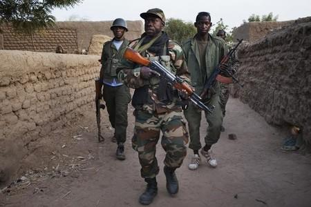 Malian soldiers patrol in the village of Kadji