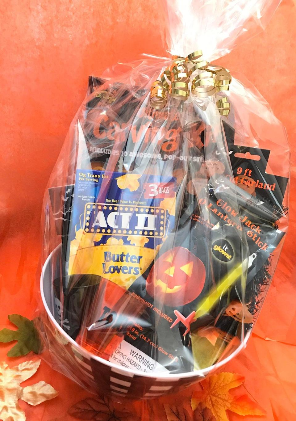 """<h2>Halloween Party Pumpkin Carving Gift Basket Set</h2> <br> <strong>Best For: The Gift Giver</strong> <br>If you know someone who LIVES for all things Halloween, then this gift basket is for them. It comes with a basic carving kit, Halloween-shot glass, popcorn, and more! <br> <br> <em>Shop</em> <strong><em><a href=""""https://www.etsy.com/shop/EARTHWINDAIRFIRE"""" rel=""""nofollow noopener"""" target=""""_blank"""" data-ylk=""""slk:EARTHWINDAIRFIRE"""" class=""""link rapid-noclick-resp"""">EARTHWINDAIRFIRE</a></em></strong> <br> <br> <strong>EARTHWINDAIRFIRE</strong> Halloween Party Pumpkin Carving Gift Basket Set, $, available at <a href=""""https://go.skimresources.com/?id=30283X879131&url=https%3A%2F%2Fwww.etsy.com%2Flisting%2F863757098%2Fhalloween-party-pumpkin-carving-gift"""" rel=""""nofollow noopener"""" target=""""_blank"""" data-ylk=""""slk:Etsy"""" class=""""link rapid-noclick-resp"""">Etsy</a>"""