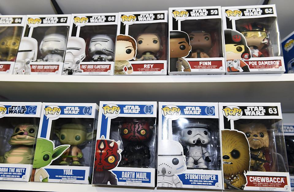 """TO GO WITH AFP STORY BY JOCELYN ZABLIT, """"The Merch Awakens: 'Star Wars' blitz before film opens"""" Funko Pop Star Wars action figures line the shelves at Meltdown Comics and Collectibles in Los Angeles on October 30, 2015. From action figures, to boxer shorts, pasta, duct tape and pet outfits, Disney is pulling out all the stops before the release of the new Star Wars movie with a massive merchandising blitz expected to reap billions. The push to drive up excitement for the film began in earnest in September -- nearly four months before """"Star Wars: Episode VII - The Force Awakens"""" hits screens -- and has been mounting since, with ecstatic fans around the globe snapping up advance tickets along with products related to the film's beloved characters.    AFP PHOTO / ROBYN BECK        (Photo credit should read ROBYN BECK/AFP/Getty Images)"""