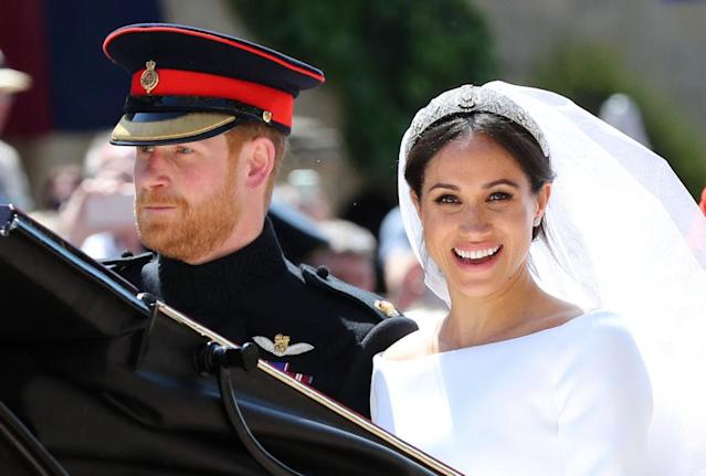 <p>Markle wore the Queen Mary's diamond bandeau tiara, which was loaned to her by the Queen. (Photo: Getty) </p>