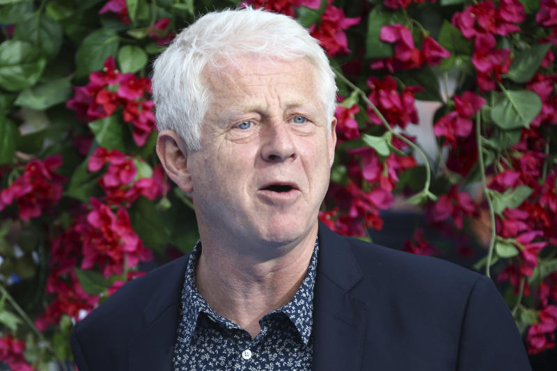 Writer Richard Curtis poses for photographers upon arrival at the World premiere of the film 'Mamma Mia! Here We Go Again', in London Monday, July 16, 2018. (Photo by Joel C Ryan/Invision/AP)