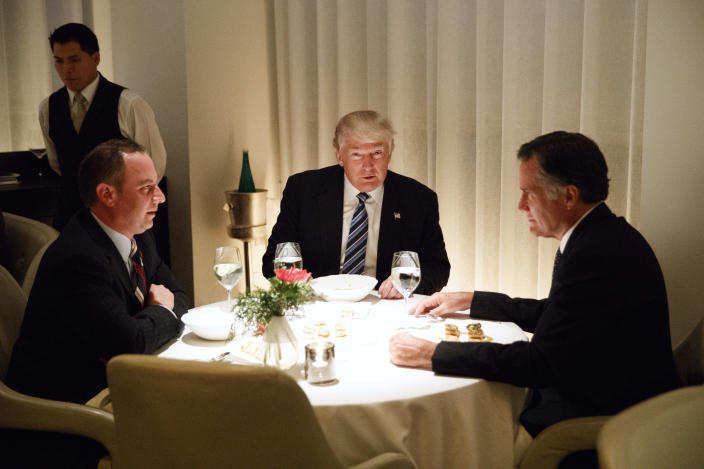 President-elect Donald Trump, center, with Mitt Romney, right, and former Trump chief of staff Reince Priebus, Nov. 29, 2016. (Evan Vucci, AP)