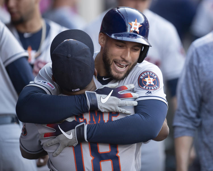 Houston Astros' George Springer, back, celebrates his solo home run with Tony Kemp during the third inning of the team's baseball game against the Los Angeles Angels in Anaheim, Calif., Thursday, July 18, 2019. (AP Photo/Kyusung Gong)
