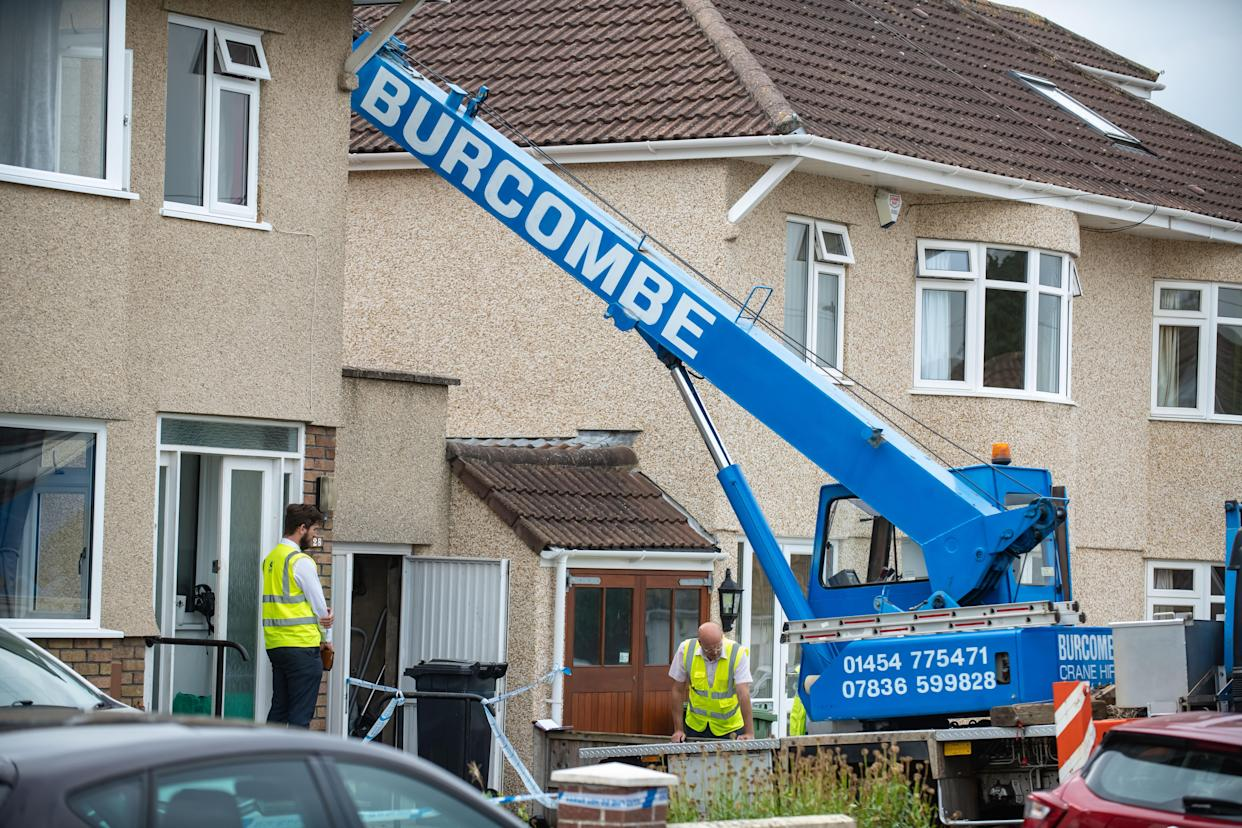 Police at the scene on Springleaze, Bristol, September 13 2021  See SWNS story SWBRcrane. Police and health and safety officials are investigating after a pensioner died when he was hit by a heavy load falling from a CRANE. Emergency services were called to the Mangotsfield area of Bristol today (Mon) after the man was struck. An Avon and Somerset police spokesman said: