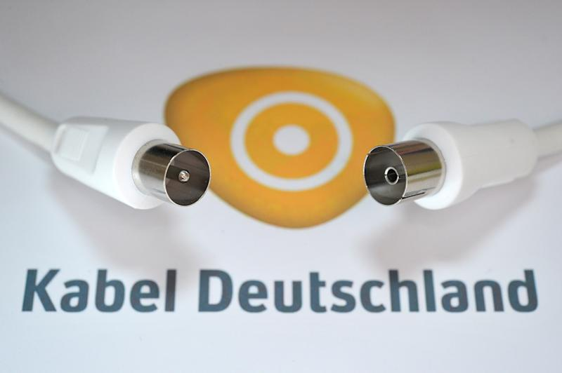 FILE - In this June 10, 2010 file photo an antenna cable is pictured on the logo of Kabel Deutschland in Bamberg, Germany. Britain's Vodafone PLC has launched a takeover bid for Germany's biggest cable operator, Kabel Deutschland, as part of its push to dominate media services in its biggest market. Vodafone, a British cellphone company with wide international interests, confirmed Monday, June 24, 2013, it will offer 87 euros per share for Kabel Deutschland. (AP Photo/dpa, David Ebener)