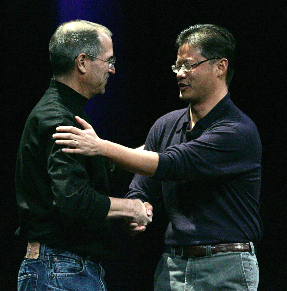 Apple Computer Inc. Chief Executive Officer Steve Jobs shakes hands with Jerry Yang, co-founder of Yahoo!