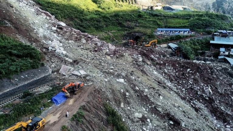 Eleven workers were pulled from the rubble after a landslide in southwest China burried a section of railway, according to state media