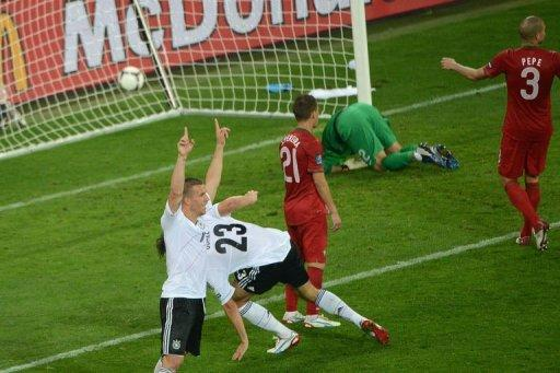 German forward Lukas Podolski (L) celebrates a goal by German forward Mario Gomez (C) as during the Euro 2012 football match at the Arena Lviv. Germany won 1-0