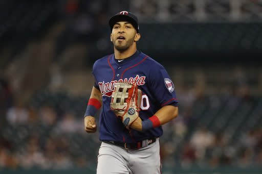 FILE - In this Sept. 24, 2019, file photo, Minnesota Twins left fielder Eddie Rosario jogs in during the baseball team's game against the Detroit Tigers in Detroit. The Twins declined Wednesday, Dec. 2, to offer a 2021 contract to Rosario, their regular left fielder for the last six seasons. (AP Photo/Paul Sancya, File)