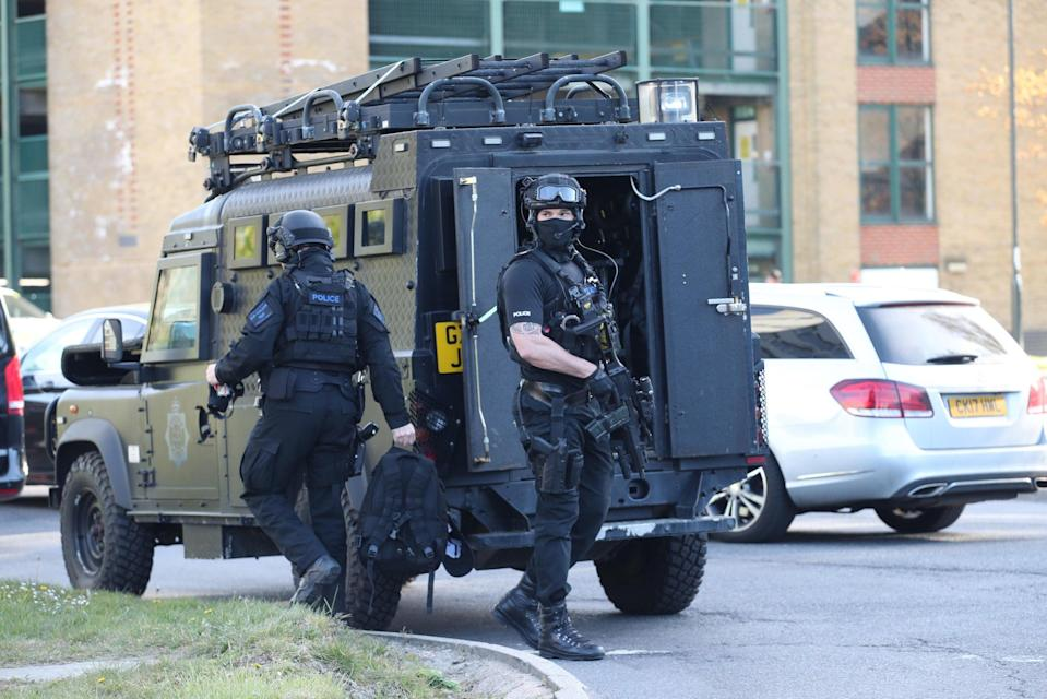 <p>Armed police at Crawley College, Crawley, West Sussex</p> (PA)