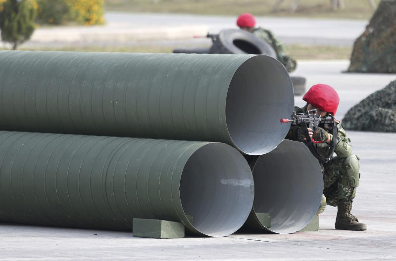 Two soldiers of fictitious enemy take part in a military exercise in Kaohsiung, southern Taiwan, Wednesday, Jan. 15, 2020. Taiwan military started a two-day joint forces exercises on Wednesday to show its determination to defend itself from Chinese threats. (AP Photo/Chiang Ying-ying)