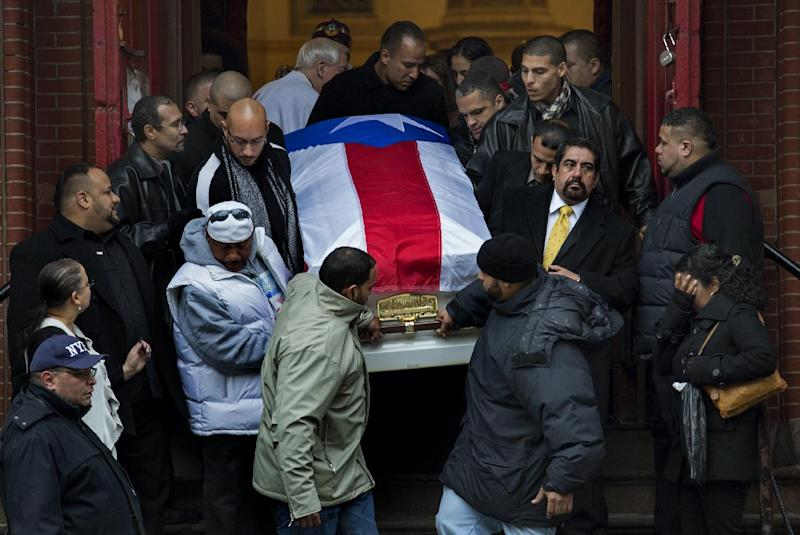 "Hector ""Macho"" Camacho's casket is brought down the steps of St. Cecilia's Roman Catholic Church in New York after his funeral Saturday, Dec. 1, 2012. Doctors pronounced Camacho dead on Saturday, Nov. 24, after he was removed from life support at his family's direction. He never regained consciousness after at least one gunman crept up to his car in a darkened parking lot in Puerto Rico and opened fire. (AP Photo/Craig Ruttle)"