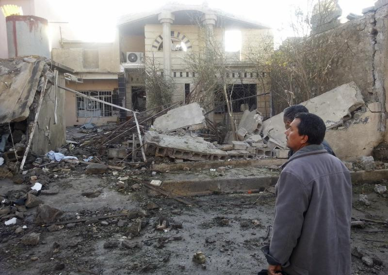 Civilians gather at the site of a car bomb attack in the town of Tuz Khurmatu