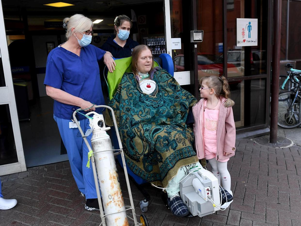 Jason Kelk is believed to be one of the UK's longest-suffering COVID patients, pictured with hospital staff and his granddaughter Felicity Wager, five. (SWNS)