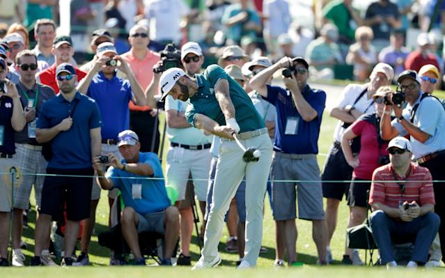 <span>Dustin Johnson unleashes a drive at the par four third</span> <span>Credit: AP </span>