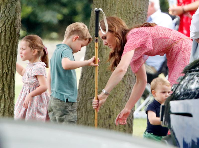 WOKINGHAM, UNITED KINGDOM - JULY 10: (EMBARGOED FOR PUBLICATION IN UK NEWSPAPERS UNTIL 24 HOURS AFTER CREATE DATE AND TIME) Princess Charlotte of Cambridge, Prince George of Cambridge, Catherine, Duchess of Cambridge and Prince Louis of Cambridge attend the King Power Royal Charity Polo Match, in which Prince William, Duke of Cambridge and Prince Harry, Duke of Sussex were competing for the Khun Vichai Srivaddhanaprabha Memorial Polo Trophy at Billingbear Polo Club on July 10, 2019 in Wokingham, England. (Photo by Max Mumby/Indigo/Getty Images)