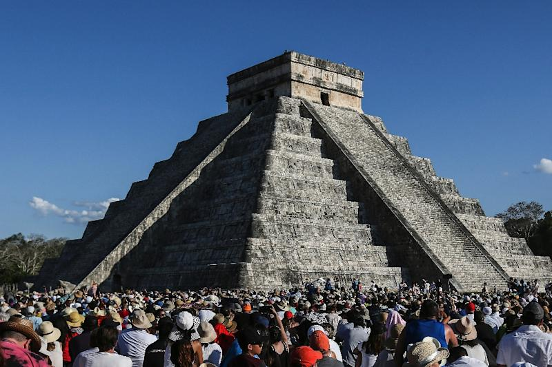 People gather at a pyramid in Chichen Itza (AFP Photo/HUGO BORGES)