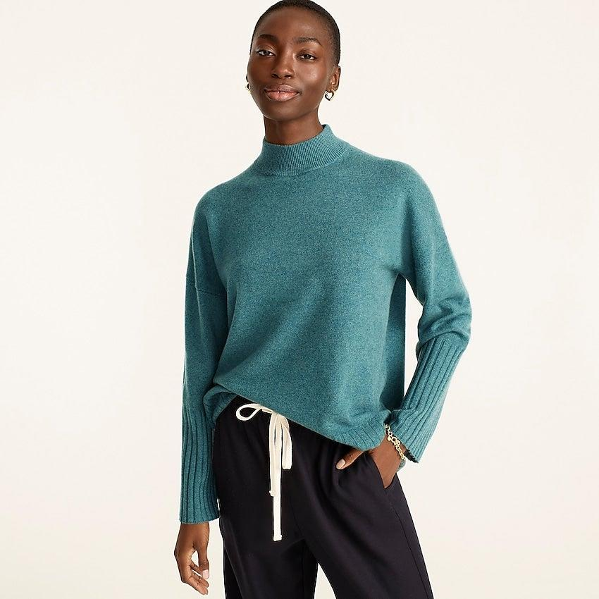 """<br><br><strong>J. Crew</strong> Cashmere mockneck sweater, $, available at <a href=""""https://go.skimresources.com/?id=30283X879131&url=https%3A%2F%2Fwww.jcrew.com%2Fp%2Fwomens%2Fcategories%2Fclothing%2Fsweaters%2Fpullovers%2Fcashmere-mockneck-sweater%2FBB404%3Fdisplay%3Dstandard%26fit%3DClassic%26color_name%3Dhthr-camel%26colorProductCode%3DBB404"""" rel=""""nofollow noopener"""" target=""""_blank"""" data-ylk=""""slk:J. Crew"""" class=""""link rapid-noclick-resp"""">J. Crew</a>"""