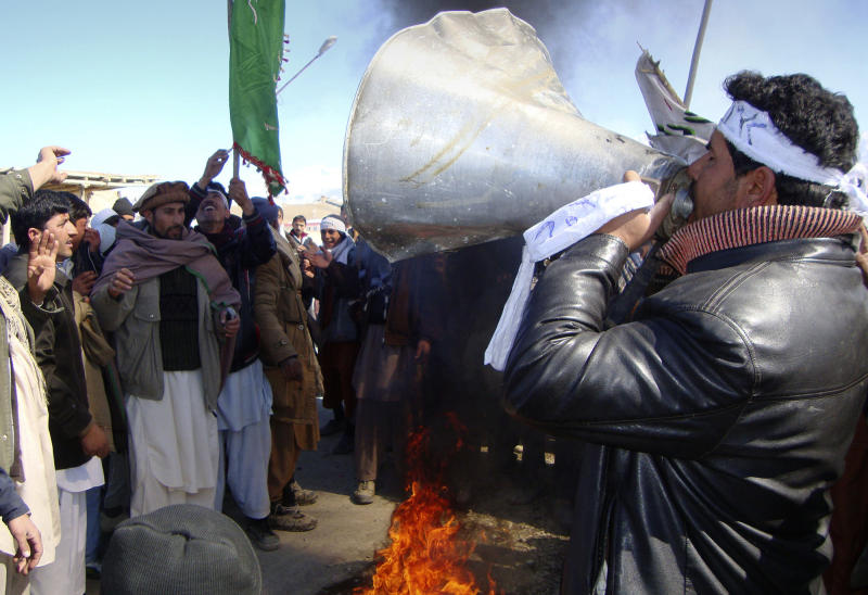 An Afghan uses a bullhorn during an anti-U.S. demonstration in Khushi, Logar province south of Kabul, Afghanistan, Thursday, Feb. 23, 2012. The Quran burnings have roiled Afghans and set off riots in an illustration of the intensity of the anger at what they perceive as foreign forces flouting their laws and insulting their culture. The U.S. has apologized for the burnings, which took place at a military base near Kabul, and said it was a mistake. (AP Photo/Obaid Ormur)
