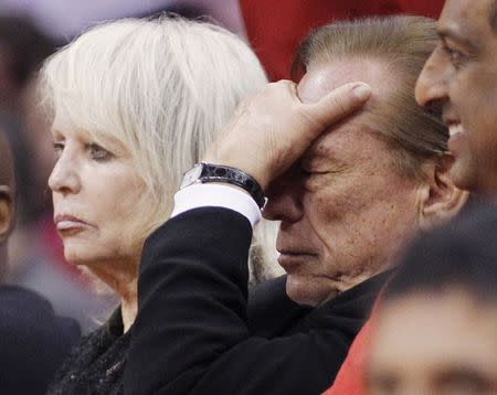 File photo of Los Angeles Clippers owner Sterling putting his hand over his face in the second half of an NBA basketball game in Los Angeles