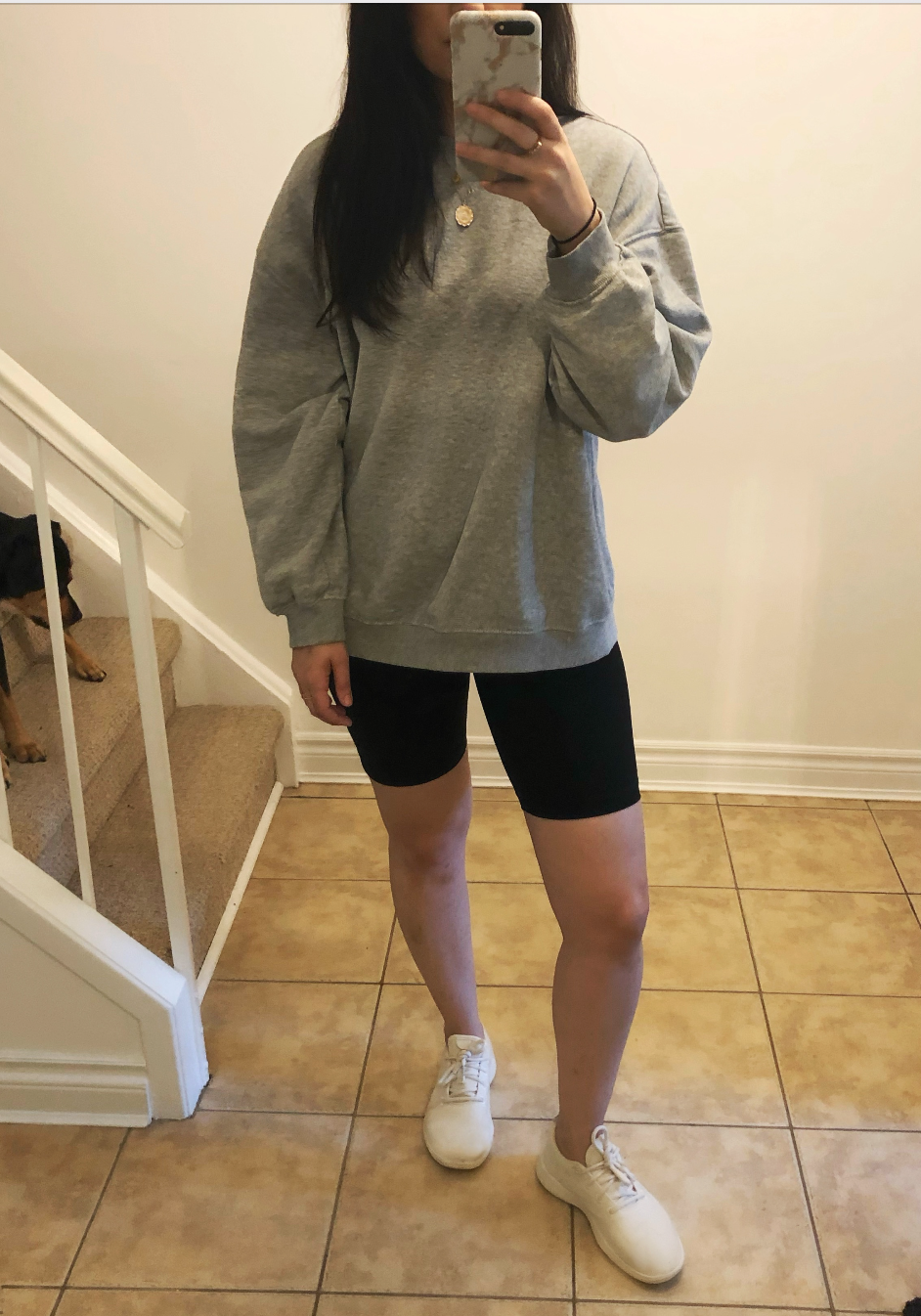 The Perform Bike Short in Black with an H&M oversized sweatshirt, Allbirds sneakers and Beagle/Rottweiler puppy.