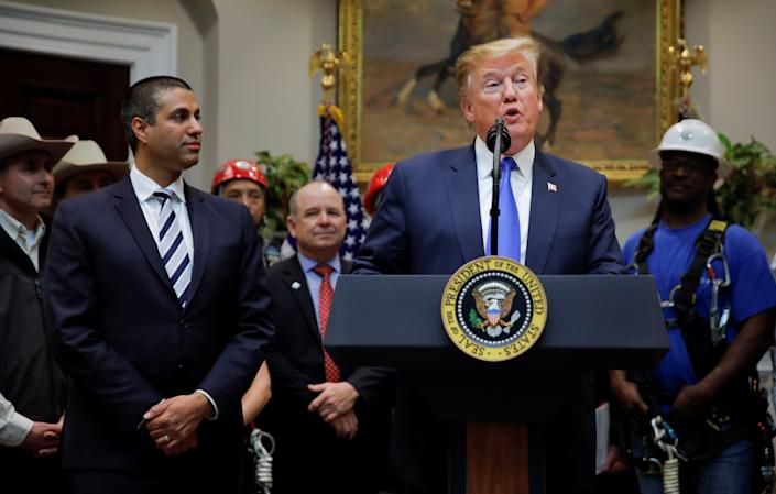 President Trump and FCC Chairman Ajit Pai at an event about United States 5G deployment on April 12. (Photo: Carlos Barria/Reuters)